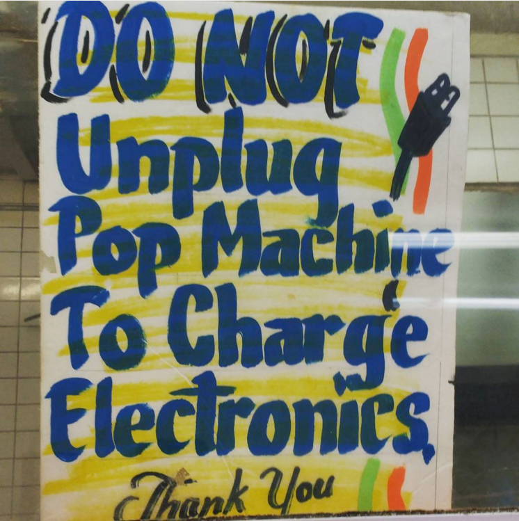 A sign written with coloured markers that says 'DO NOT unplug the pop machine to charge electronics. Thank you.' Found inside Harold's chicken shack at Hyde Park, Chicago.