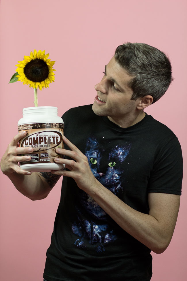 Photo of Brad looking at sunflower in a protein jar.